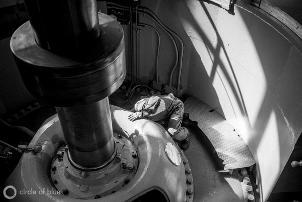 Abe Sanchez, a mechanic at the C.W. Jones Pumping Plant, looks for the source of a small water leak in one of the facility's massive electrical pumps.