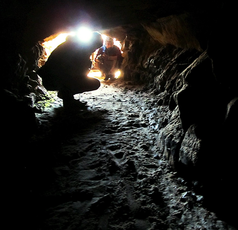 Rathole mines east of Shillong, India are so narrow a full-grown western man must crawl on hands and knees. Mine tunnels can be a kilometer-long and take miners an hour to reach the coal face.