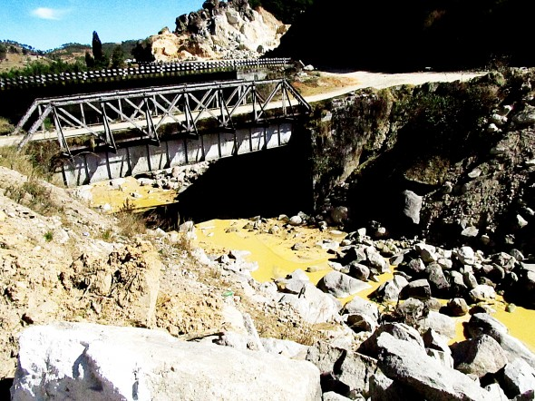 Unregulated sand mining along Meghalaya's river banks turns streams yellow.