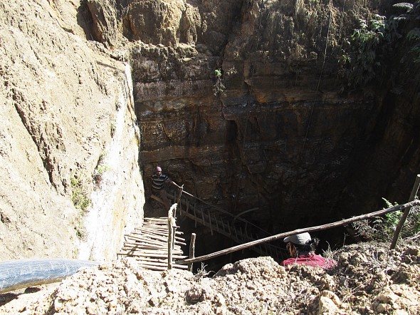 Thousands of deep and dangerous box coal mines like this one in the Jiantia Hills pour pollution into the water and cause mining deaths and injuries.
