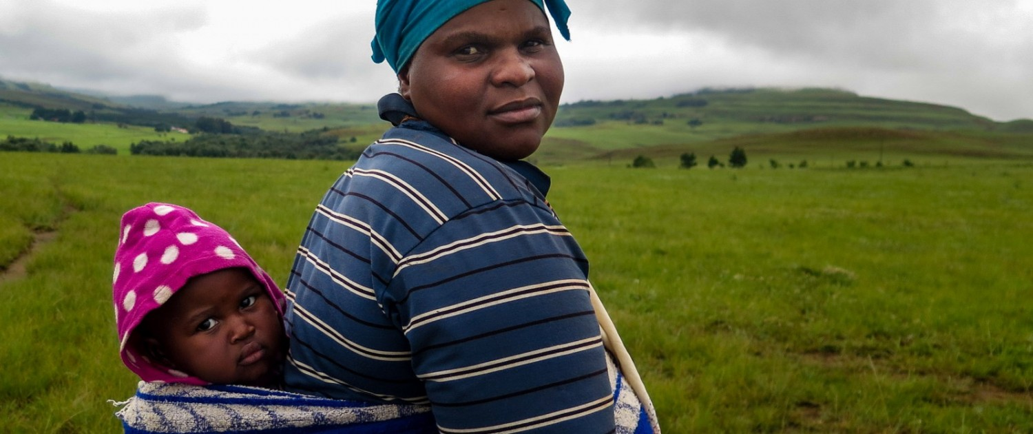 Zulu villagers in the Vryheid region are nervous about new coal mine proposals. Juliette Ndosi and her son, Tobi, live in a family compound near a proposed mine. The project might mean job opportunities, she said. It could also force her family to move. Photo © Keith Schneider / Circle of Blue