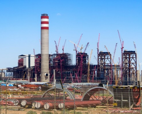 The 4,800-megawatt Kusile coal-fired generating station east of Johannesburg, years overdue and billions of dollars over budget, is at the center of the damaging economic, social, and ecological vortex engulfing South Africa. Photo © Keith Schneider / Circle of Blue.