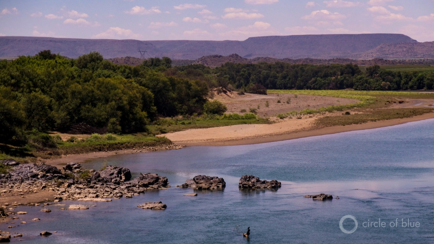 The Orange River, drained by a deep drought, is one of the Karoo's primary sources of fresh water. Much of the river's water is devoted to desert agriculture. Photo © Keith Schneider / Circle of Blue