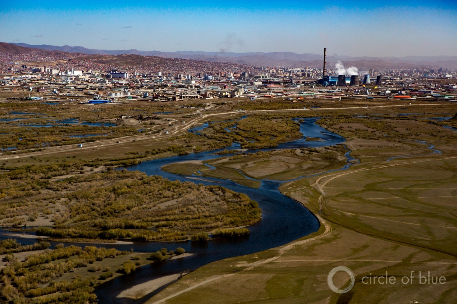 """Coal-fired power in Ulan Bator, Mongolia. Much of the analysis on financial losses focuses on the plunge in oil and coal prices, and the potential that a huge portion of the global reserves of oil, gas, and coal will be """"stranded' in the ground to curb climate change. Photo © J. Carl Ganter / Circle of Blue"""