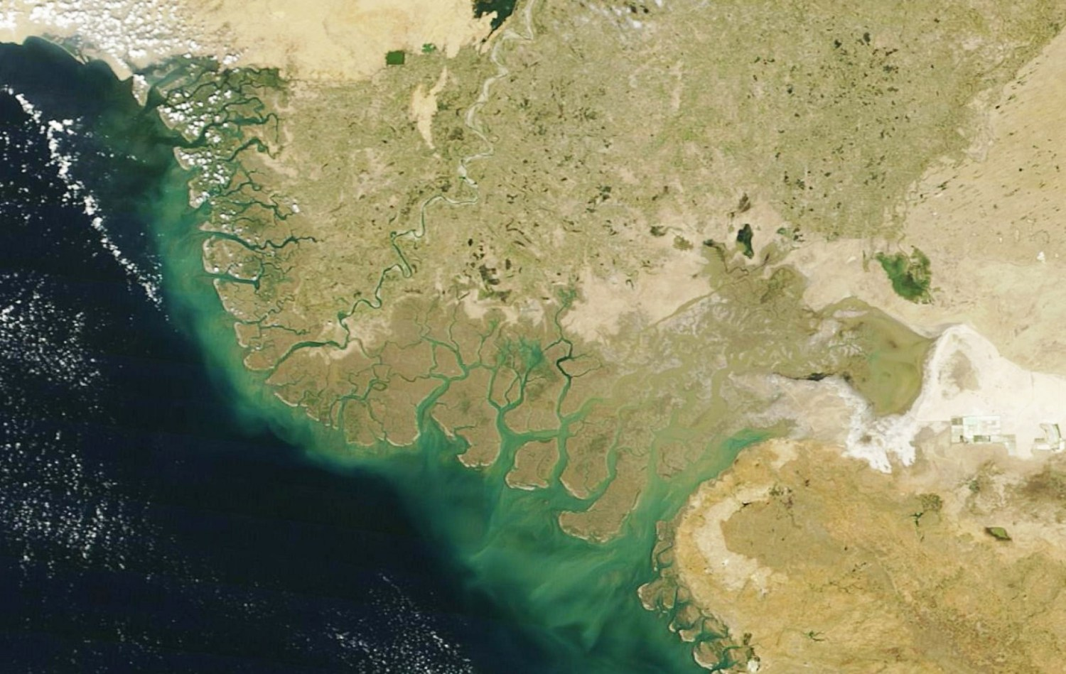 The Indus River travels 3,000 kilometers from the Himalayas before it empties into the Arabian Sea near Karachi. While groundwater reserves are rapidly declining in the upper reaches of the basin, groundwater in the lower basin is salty and largely unusable. This image of the Indus River Delta was captured in March 2016 by the Moderate Resolution Imaging Spectroradiometer (MODIS) sensor on board the Terra satellite. Photo courtesy NASA