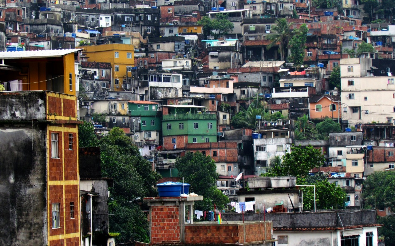 Rio de Janeiro's sprawling favelas often lack access to adequate water and sewage services, compounding pollution problems in Guanabara Bay. Photo courtesy David Berkowitz via Flickr Creative Commons