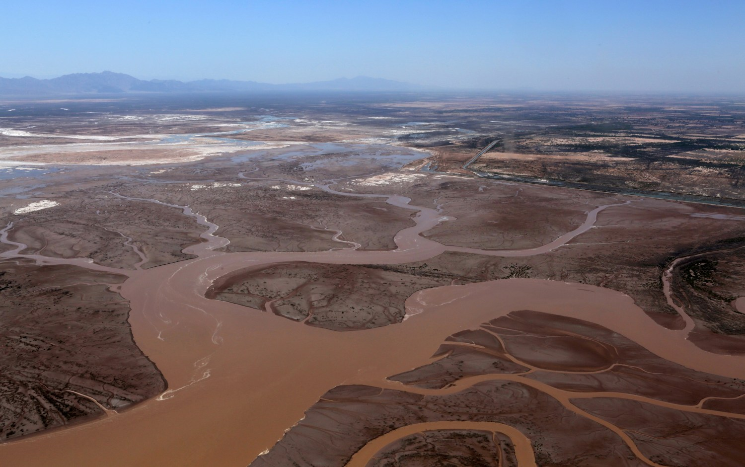 Water from the Colorado River flows into the Gulf of California in this photo taken on May 23, 2014. The short-term flush of water, which took place over eight weeks, had lasting ecological and social effects. Photo courtesy of Francisco Zamora/Sonoran Institute
