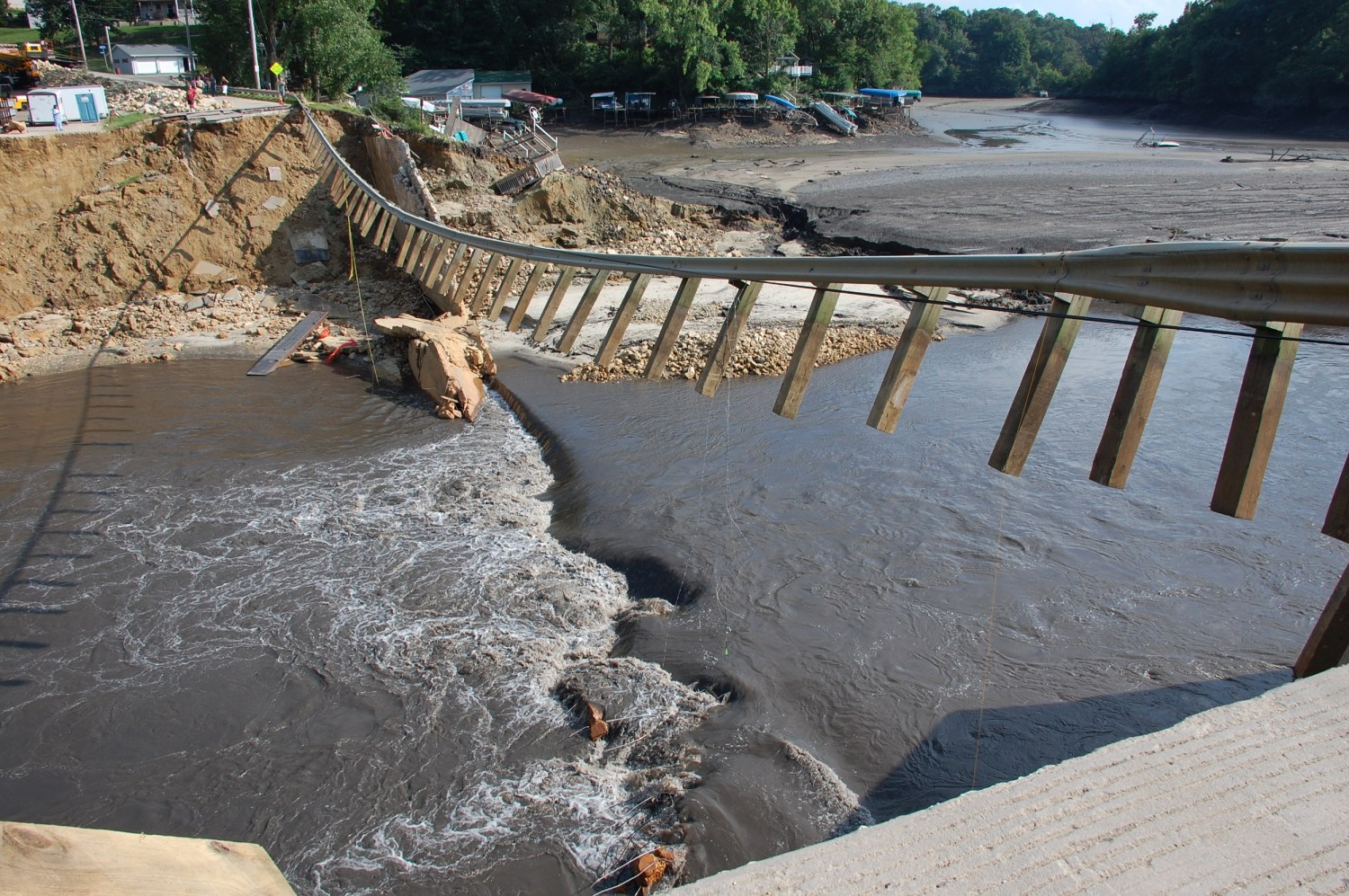 The remains of the Lake Delhi Dam, in Iowa, after the 59-foot-high structure failed during a heavy rainstorm in July 2010. Photo by Josh deBerge / FEMA