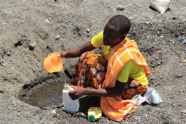At a dried up river bed, a woman fills a water jug near Kataboi in northern Kenya. Picture: Marisol Grandon/Department for International Development
