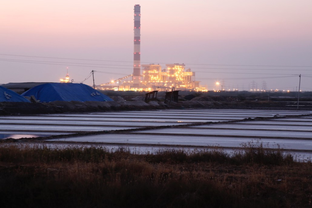 Coal-fired power plants still dominate Tamil Nadu's electrical supply grid. Here a sea water-cooled power plant, framed by salt-making evaporation ponds, along the Bay of Bengal in Tuticorin. Photo/Dhruv Malhotra