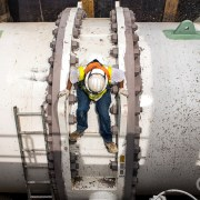 Javier Serafin, a Los Angeles Department of Water and Power utility worker, climbs on a 144-inch outlet, which connects to an ultraviolet treatment plant that will be completed in 2019. Photo © J. Carl Ganter / Circle of Blue
