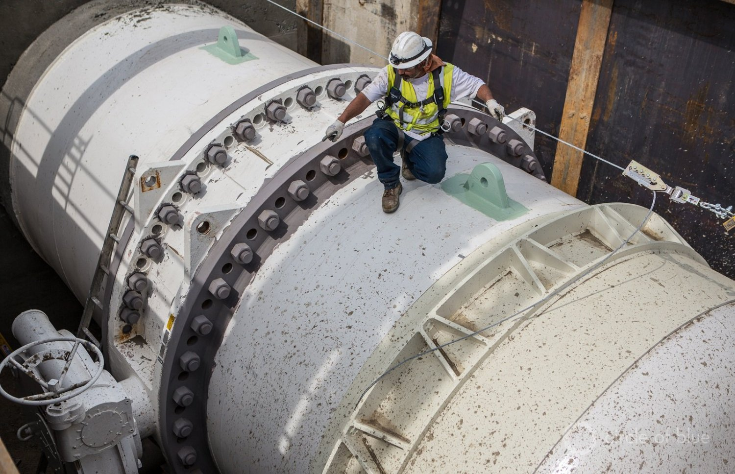 Los Angeles Department of Water and Power workers install a 144-inch pipe that will connect to an ultraviolet treatment plant.