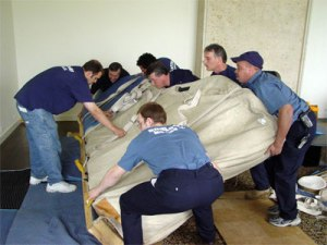 team moving furniture