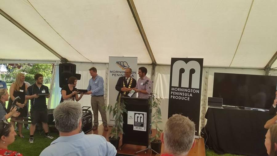 Mayor Graham Pittock awarding certificates to local producers
