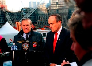 011114-D-9880W-120Secretary of Defense Donald H. Rumsfeld (left) and New York Mayor Rudolph Giuliani (right) hold a joint media availability at the site of the World Trade Center disaster in lower Manhattan, on Nov. 14, 2001.  Rumsfeld is visiting the site of the Sept. 11th disaster to speak to Giuliani, officials from the N.Y. Fire Department and the Office of Emergency Management.  DoD photo by R. D. Ward.  (Released)