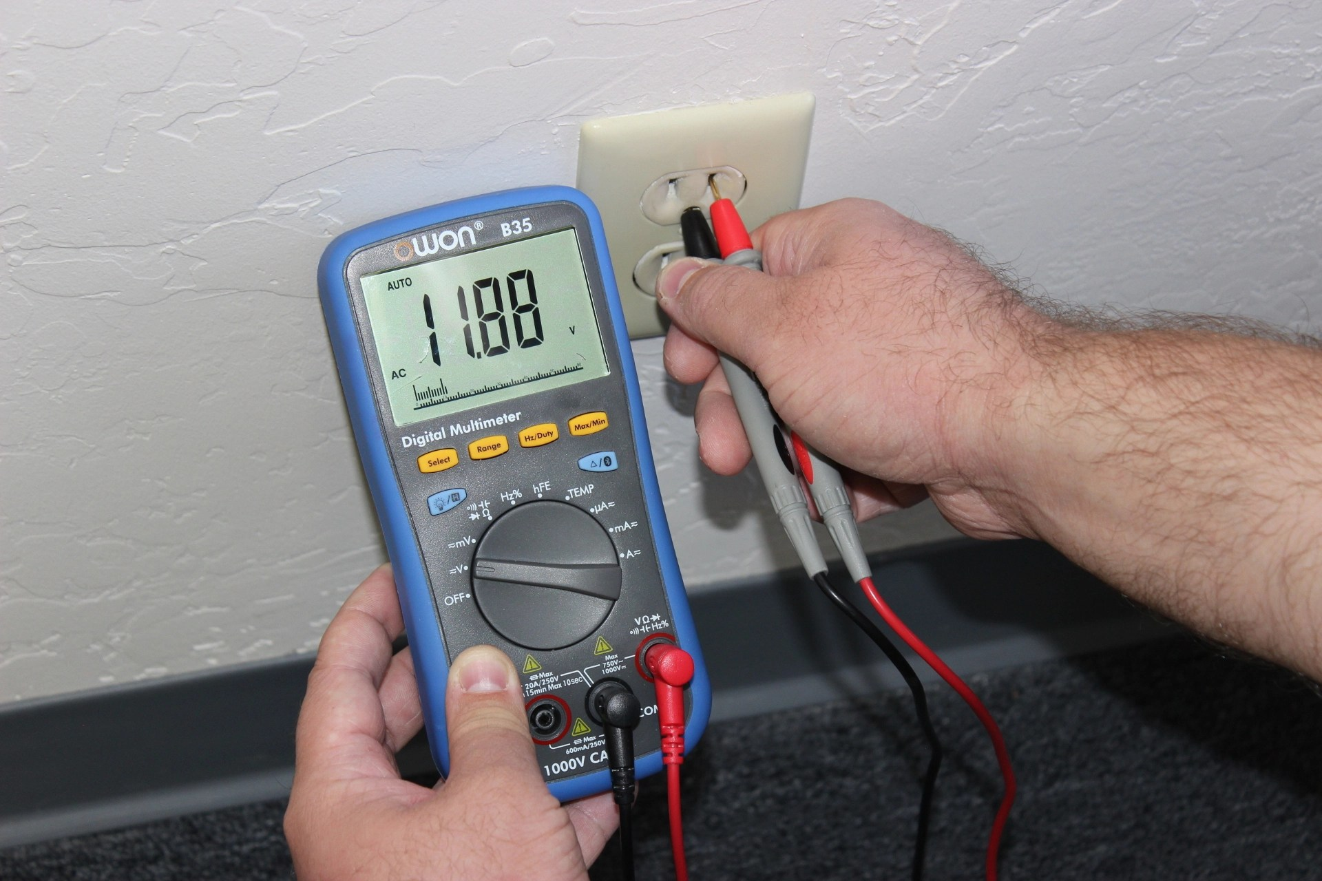testing an electrical outlet using a digital multimeter