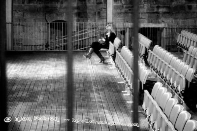 Caged woman alone