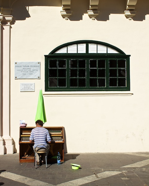 Pianist. Green window