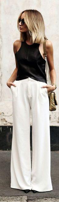 top preto e calça branca pantalona