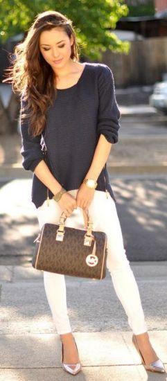 suéter preto com calça skinny branca
