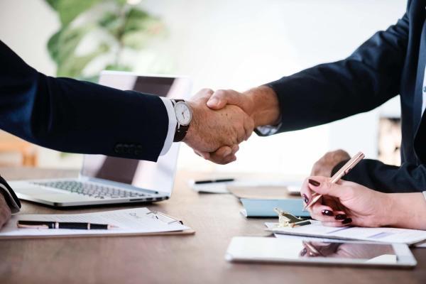 men in suit shaking hands