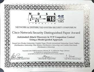 Photo of NDSS 2018 Distinguished Paper Award