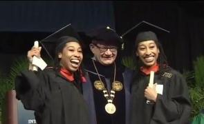 Photo of the Witherspoon Twins at receiving their Masters in Information Technology degree