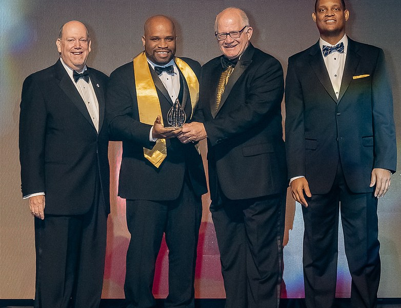 Photo of Tariq King accepting the FIU Torch Award