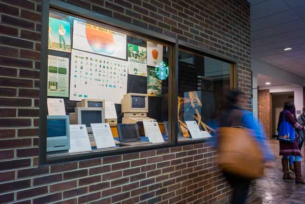 student walks by computing museum