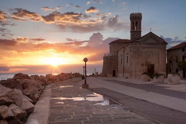 19 May 2013, Piran --- Promenade with Church of San Clemente, Piran, Istria, Slovenia, Europe --- Image by © Franz Walter/imageBROKER/Corbis