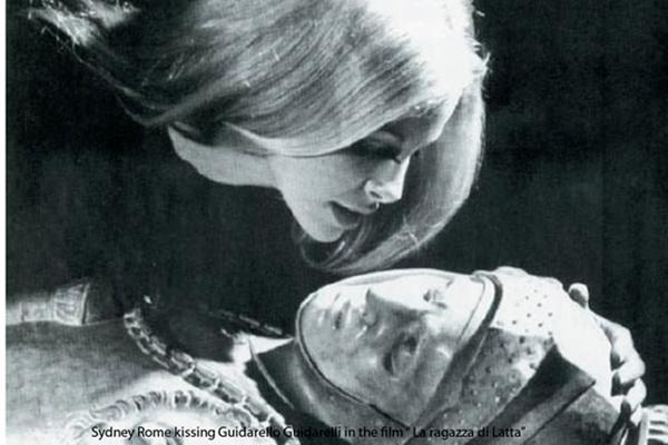 """Sydne Rome Kissing Guidarello in a scene of the film """"La Ragazza di Latta"""""""
