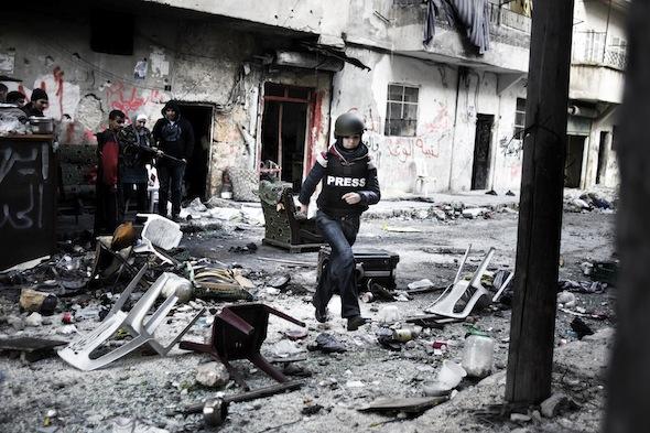 Maximum risk The author dodges sniper fire in Aleppo's Salaheddin neighborhood. ( Photo © Alessio Romenzi