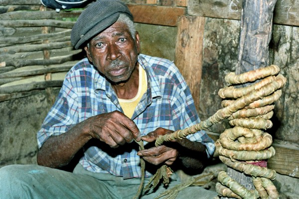 Roy's maternal grandfather Alfred Rowe, twisting tobacco  Courtesy of Roy Anderson