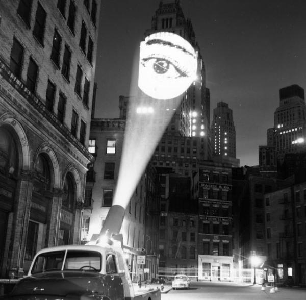 """fullscreen """"An image of an eye is projected onto a building at New York by a skyjector. February 1960.""""(Getty)"""