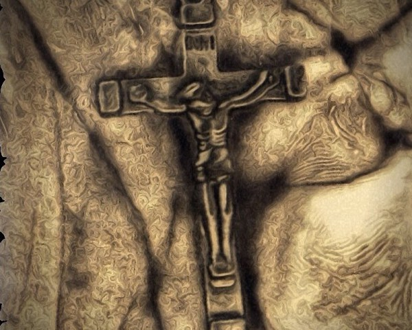 Crucifix that hangs from my rear view mirror in my work vehicle. ©Myron Ropp