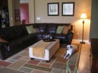 Decorating with leather sofa (mirror, hardwood floors ...