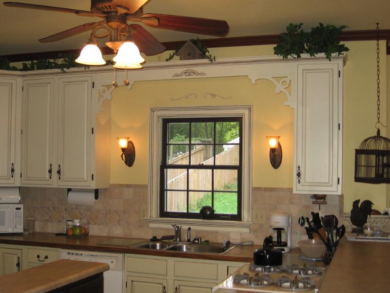 Kitchen Cabinets With Handles On Center Panel?? Ugh!! Hardwood