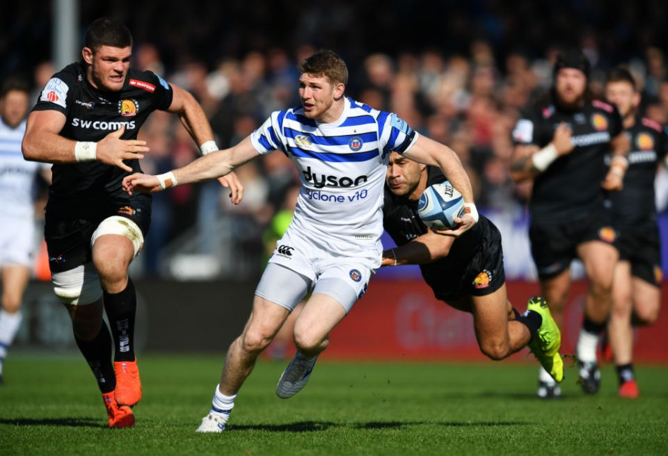 EXETER, ENGLAND - MARCH 24:  Ruaridh McConnochie of Bath Rugby evades Olly Woodburn of Exeter Chiefs during the Gallagher Premiership Rugby match between Exeter Chiefs and Bath Rugby at Sandy Park on March 24, 2019 in Exeter, United Kingdom. (Photo by Dan Mullan/Getty Images)