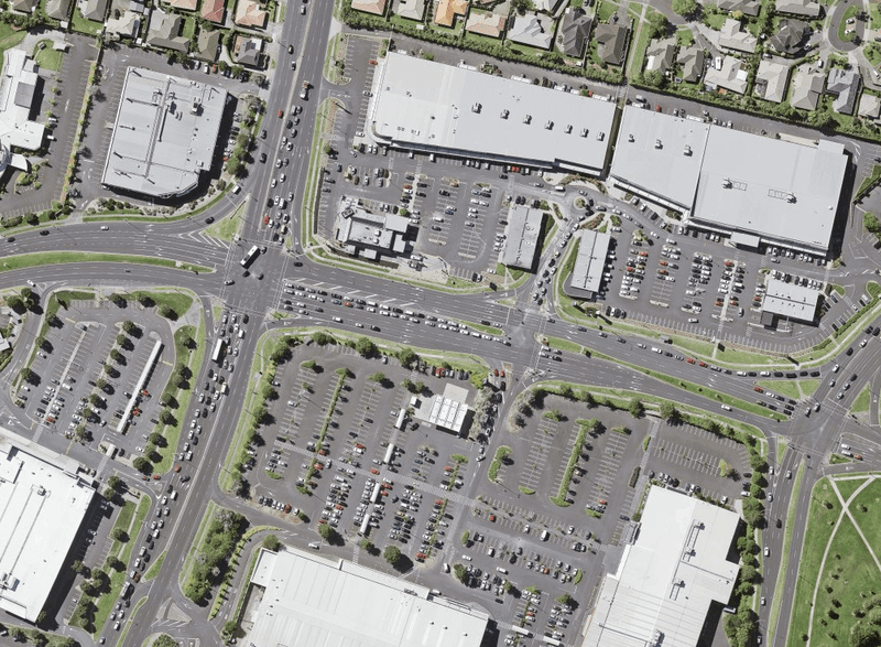 Aerial view of Botany, Auckland, a place with most of its land devoted to storing or moving cars