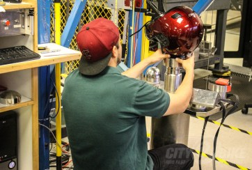 ...and sets up another on the testing equipment. Photo: Angelica Rubalcaba.