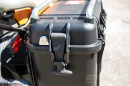 Close-up of lock and rubber hold-down strap on AcmeMoto2 pannier.