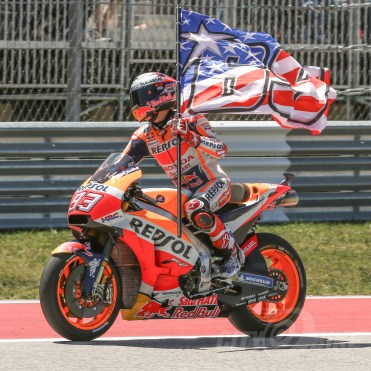 Marc Marquez took the win in Austin and then took a victory lap with a flag honoring Nicky Hayden.