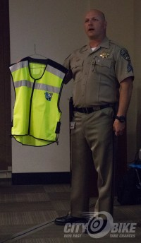 Sergeant Larry Starkey shows off one of the CMSP high-viz vests.
