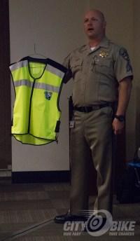 Sergeant Larry Starkey shows off one of the CMSP high-viz vests.