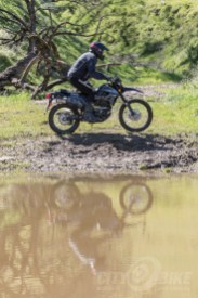 Kawasaki KLX250 in the mud.