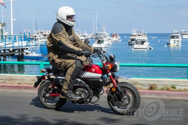 Aerostich Cousin Jeremy Roadcrafter Suit on Honda Monkey.