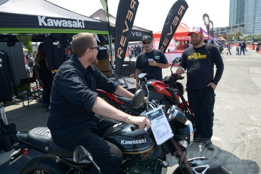 Holzfeuer checks out the Z900RS; Tony from SF Moto and Fish provide encouragement.