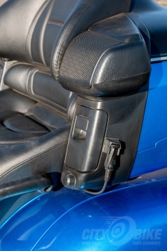 Passenger armrest with headset connector...