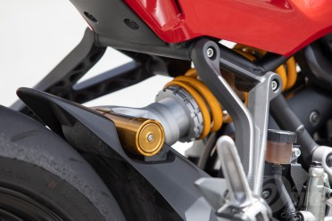 Öhlins rear shock and reservoir. Yellow spring, of course.