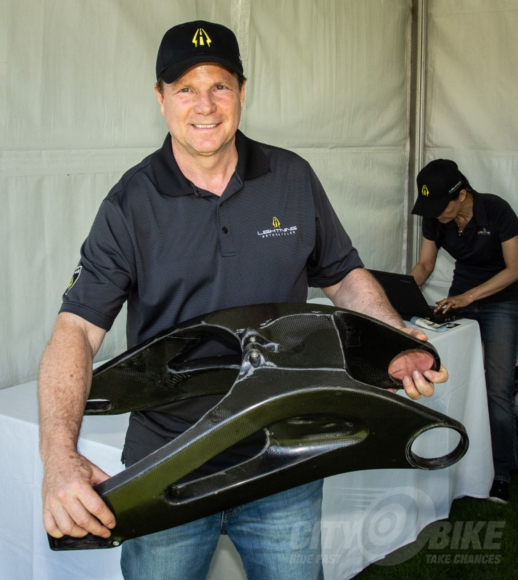 Lightning Motorcycles founder and CEO showing off a carbon swingarm prototype for the LS-218 at the 2016 Quail Motorcycle Gathering. Photo: Surj Gish.